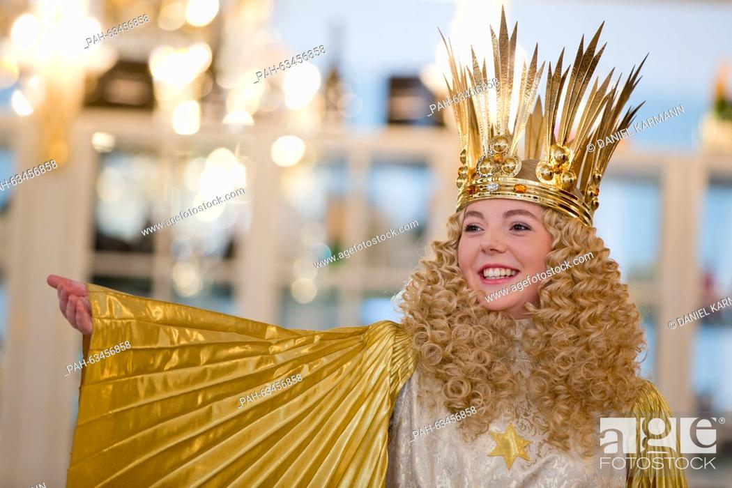 Stock Photo: The new Nuremberg Christkind (lit. Christ Child), Barbara Otto, poses in her official garments during a fitting in Nuremberg, Germany, 10 November 2015.