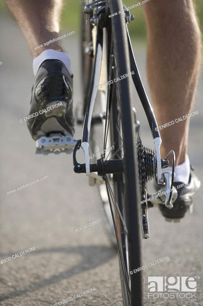 Stock Photo: Detail of a cyclist pedaling.