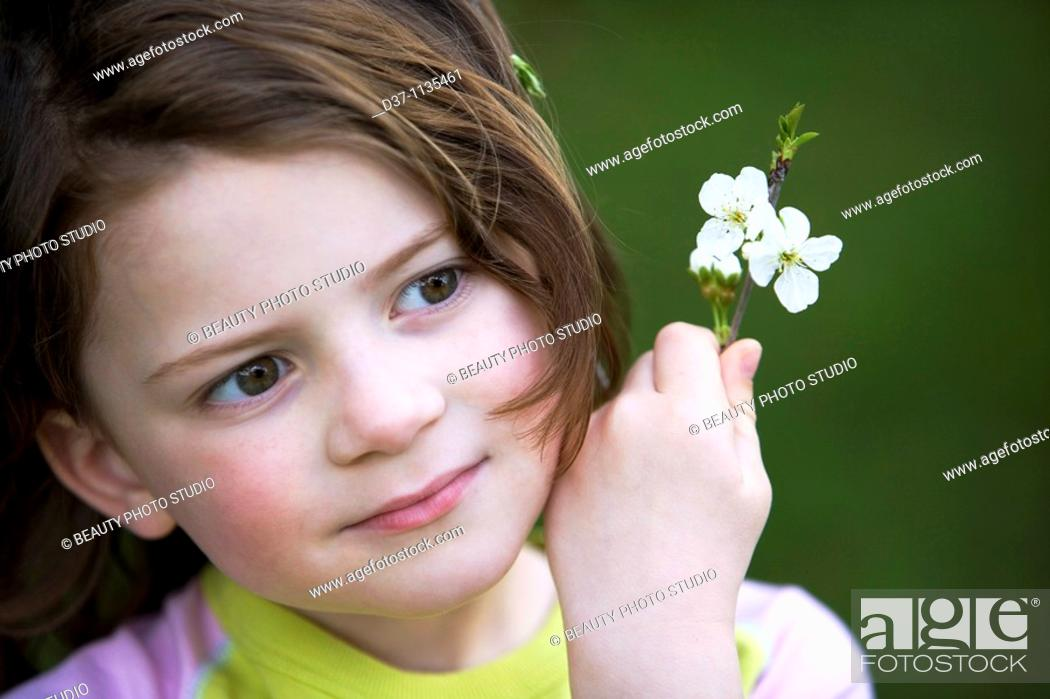 Stock Photo: Young girl with flowers.