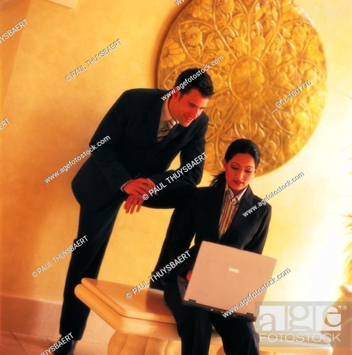 Stock Photo: Businesspeople using laptop.
