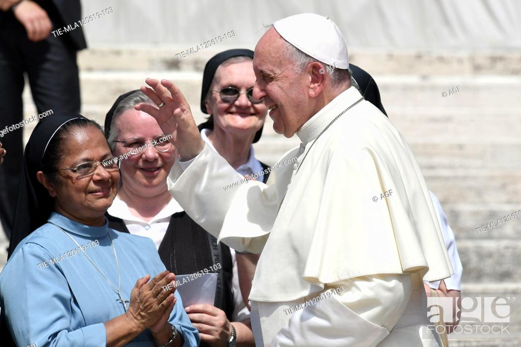 Stock Photo: Pope Francis greets faithful during weekly general audience, Vatican City, Italy - 12 Jun 2019.