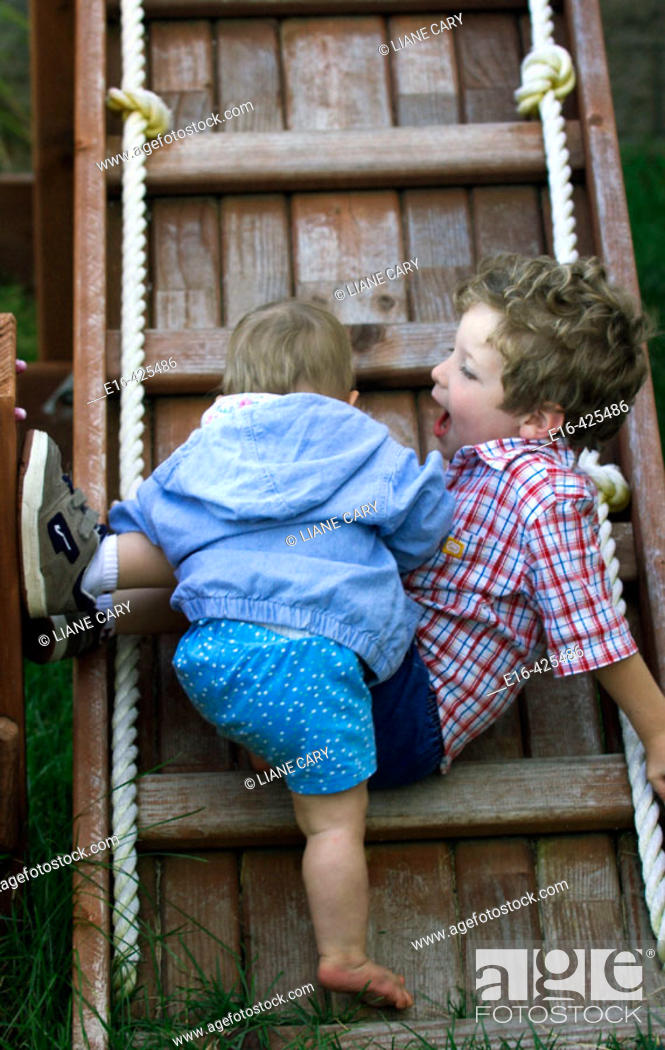 Stock Photo: Baby and brother on ladder.