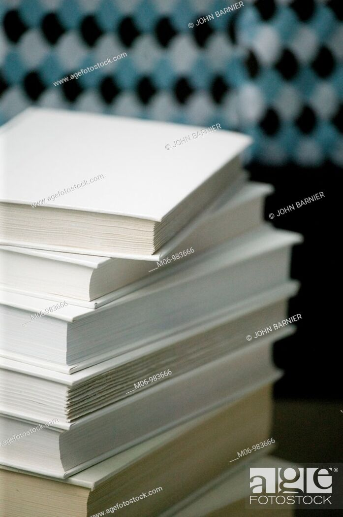 Stock Photo: Stack of White Books Near Bed.