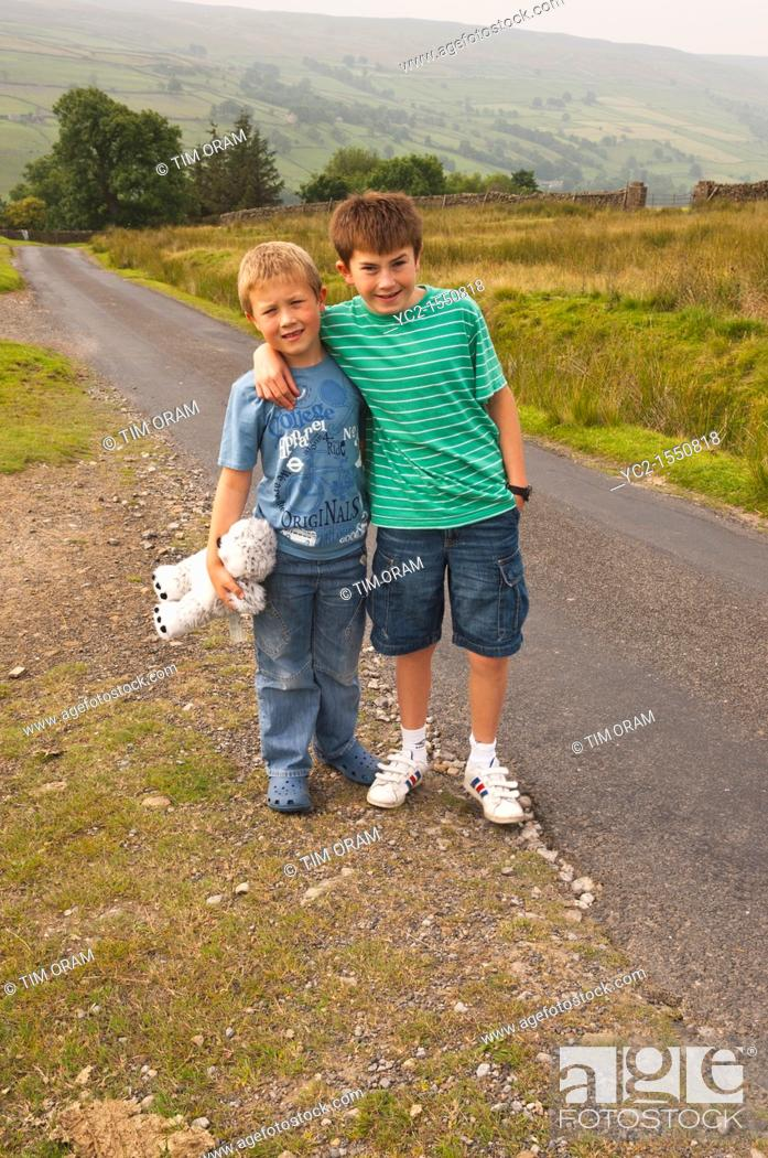 Stock Photo: Two brothers walking in Swaledale in North Yorkshire , England , Britain , Uk.