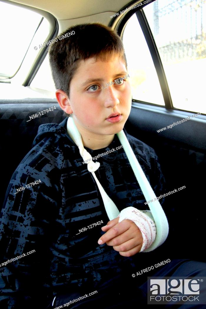 Stock Photo: Boy with broken arm.