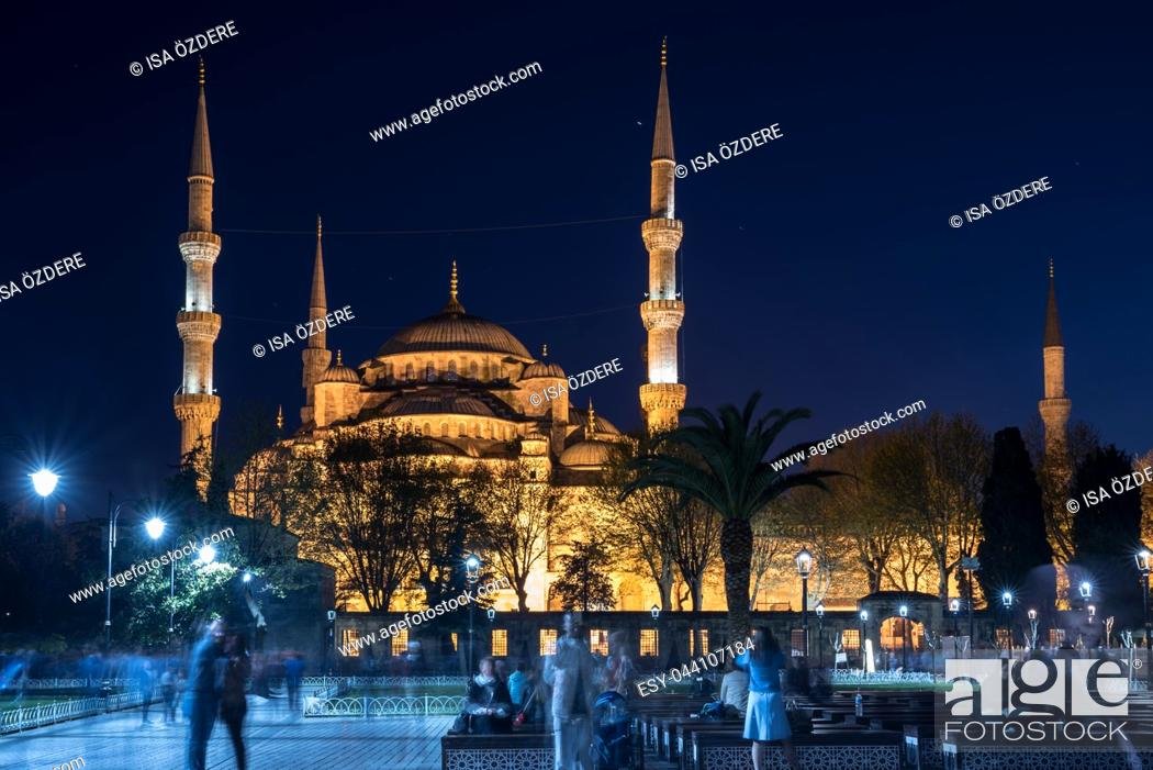 Stock Photo: Unidentified people sit in front of Sultanahmet Mosque or Blue Mosque on background in Istanbul,Turkey. 21 April 2018.