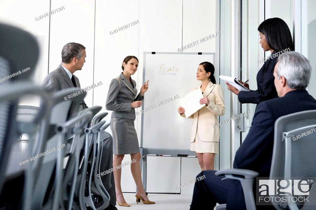 Stock Photo: Business people in meeting in conference room.