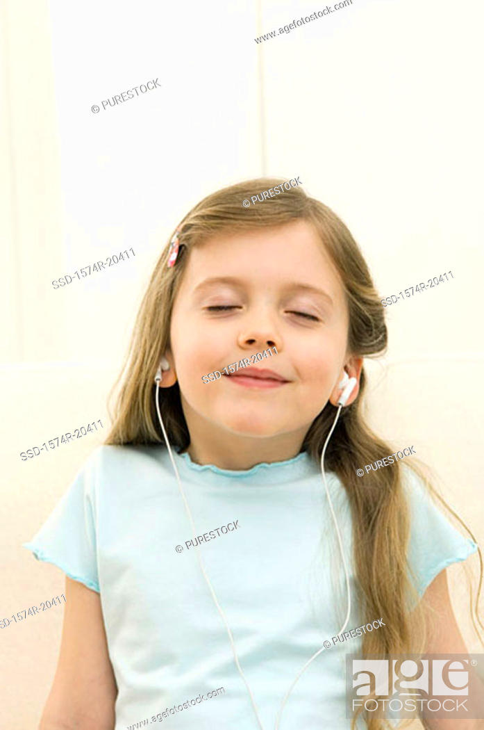 Stock Photo: Close-up of a girl wearing headphones and listening to music.