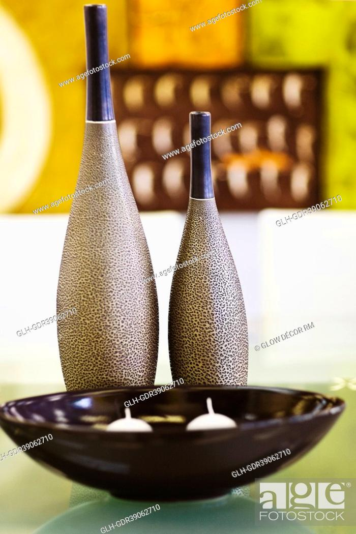 Photo de stock: Decorative urn and decorative balls on a table.