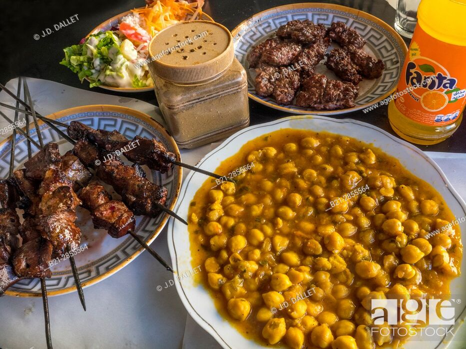 """Stock Photo: Morocco, Food, """"Lrver Kebab"""", Salad, peak peans, and """"Kefta"""" (grilled mince meat) with a Fanta, ..."""