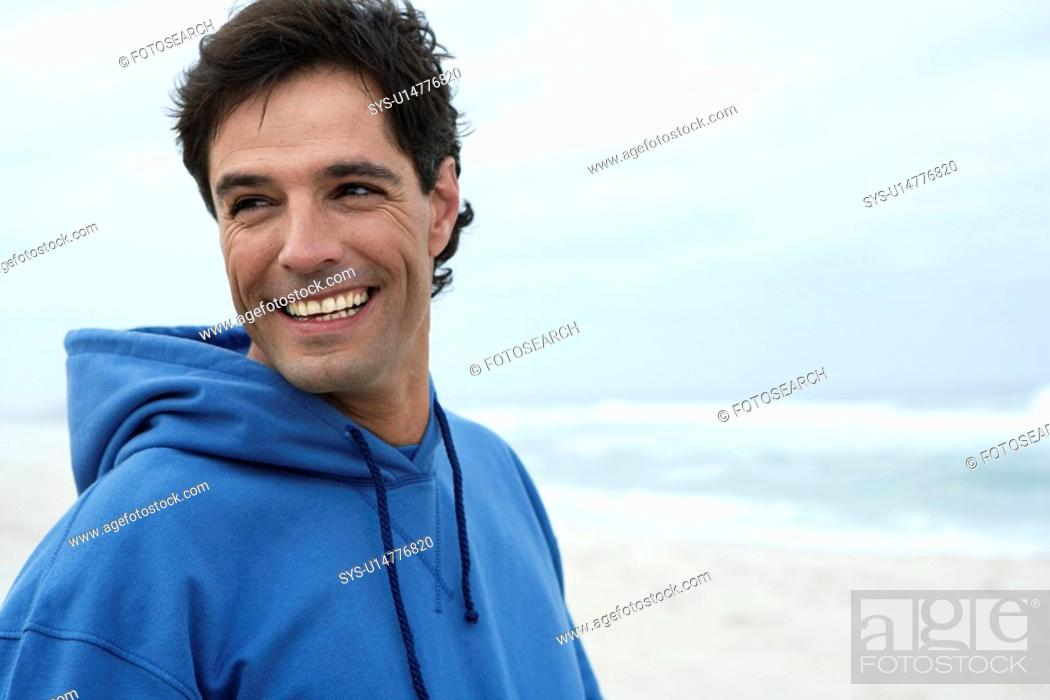 Stock Photo: Portrait of mid adult man on beach.