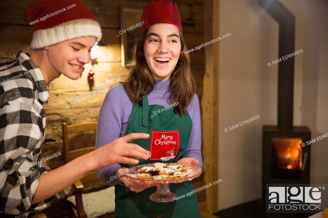 Stock Photo: Brother and sister with Christmas cookies.