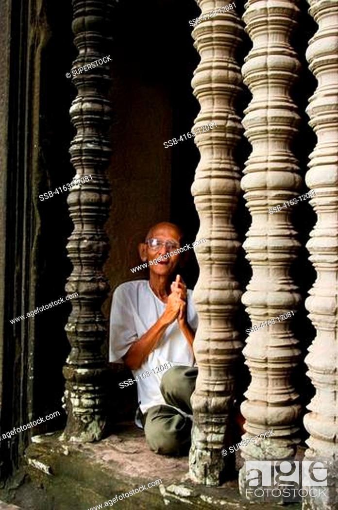 Stock Photo: CAMBODIA, ANGKOR, ANGKOR WAT, GALLERY, OLD MAN IN WINDOW.