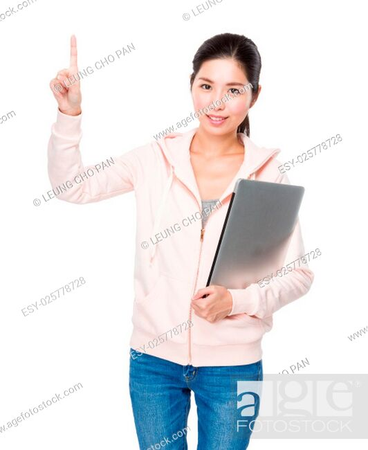 Stock Photo: Young woman hold with laptop computer and finger point up.
