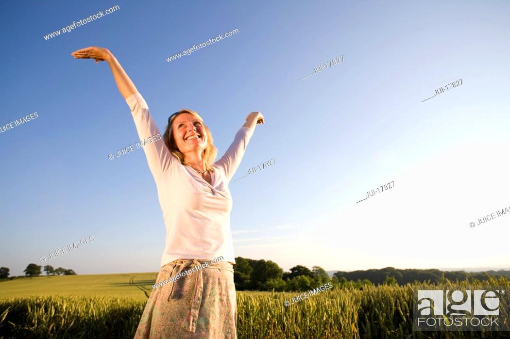Stock Photo: Woman standing in field.