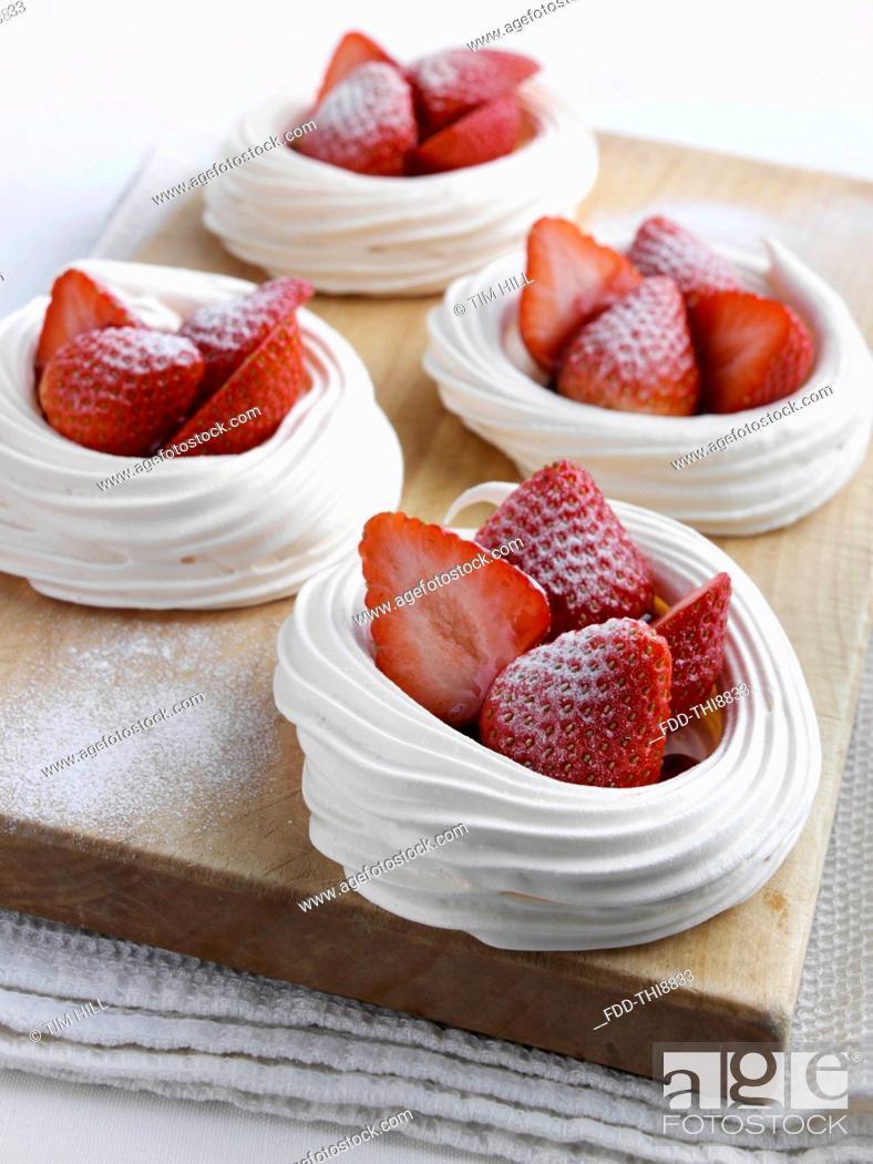 Stock Photo: Strawberry meringue nests.