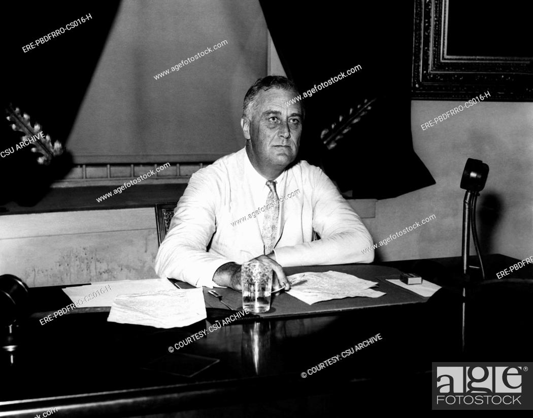 Stock Photo: President Franklin D. Roosevelt 1882-1945, in the Oval Office, circa 1933. CSU Archives/Courtesy Everett Collection.