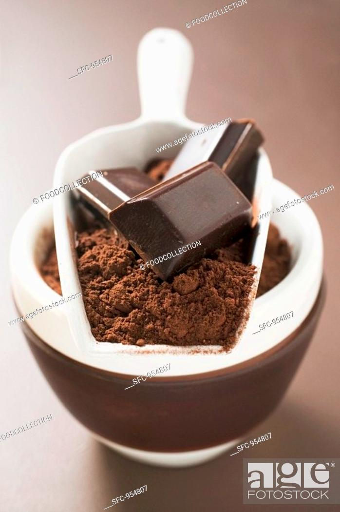 Stock Photo: Pieces of chocolate and cocoa powder in scoop and bowl.