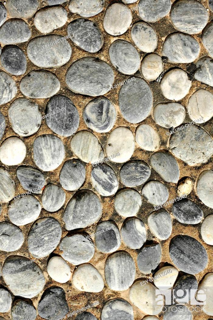 Stock Photo: abstract background with round peeble stones.