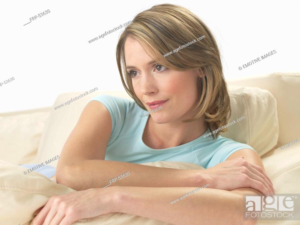Stock Photo: Woman on the sofa.