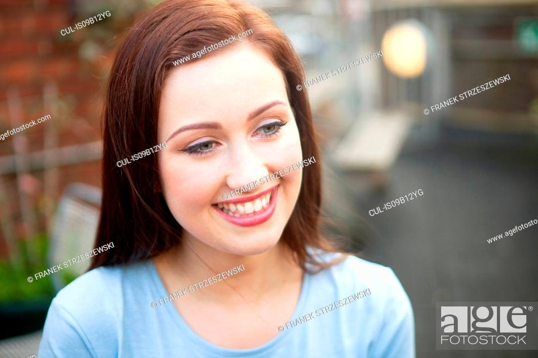Stock Photo: Young woman smiling.