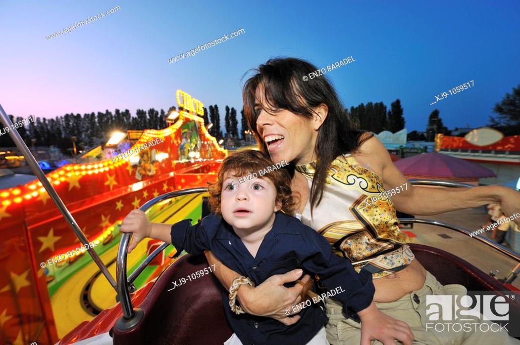 Stock Photo: Mother and child on rides and ferris wheel.