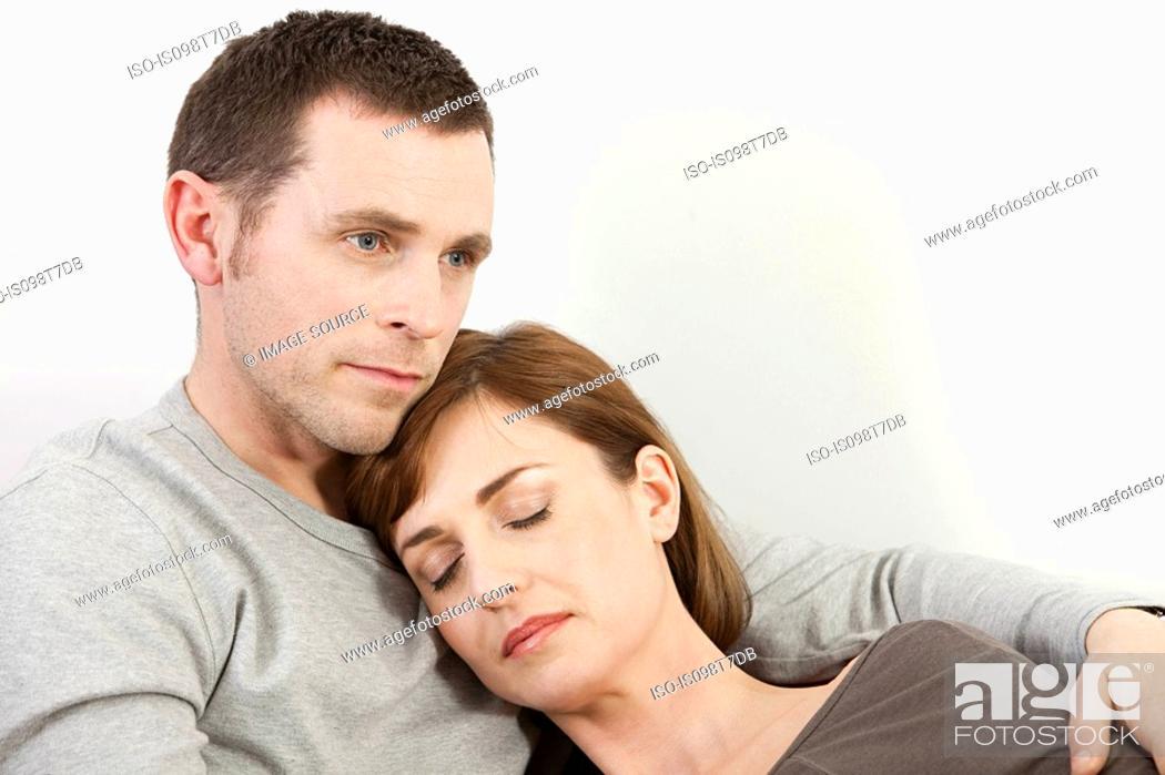 Stock Photo: Sleeping woman resting on husband.