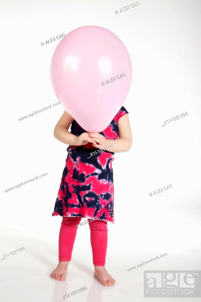 Stock Photo: Girl holding balloon.