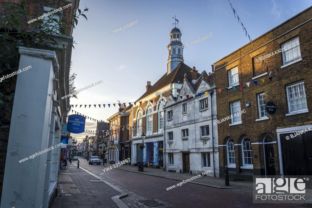 Stock Photo: Rochester High Street and Visitor Centre and Art Gallery situated in in a historical building with a tower, Rochester, Kent, England, UK.