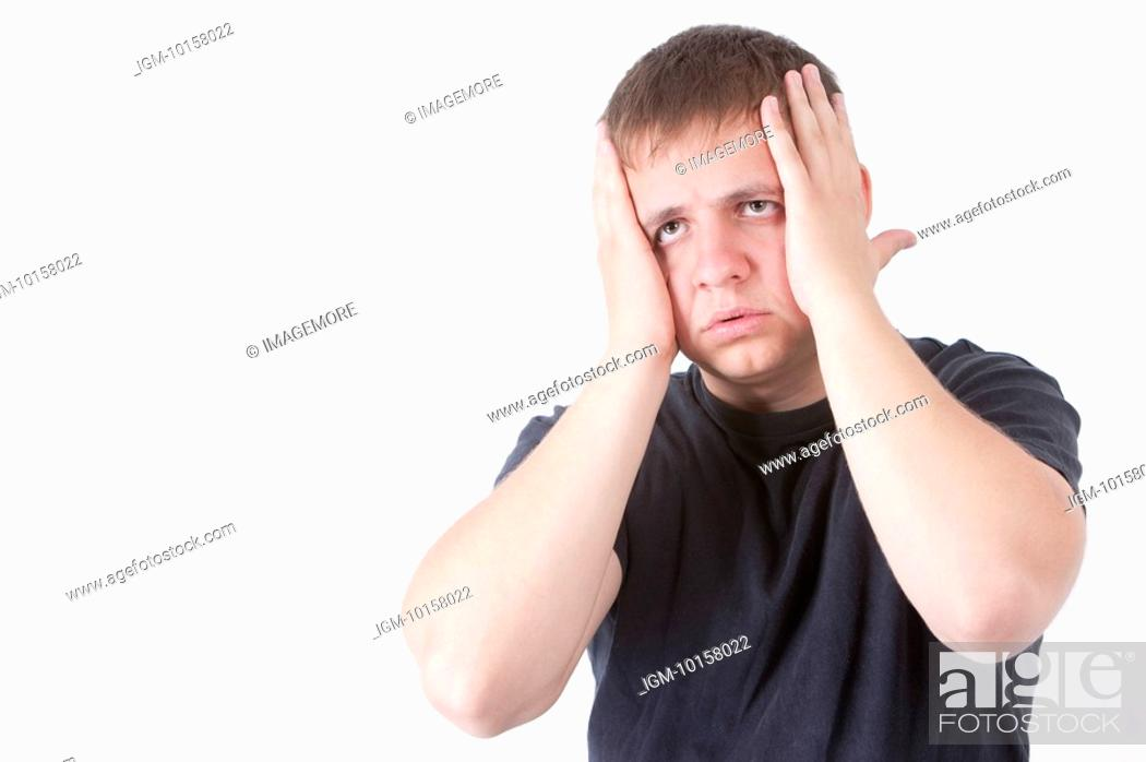 Stock Photo: Young man putting hands on head with anxiety.