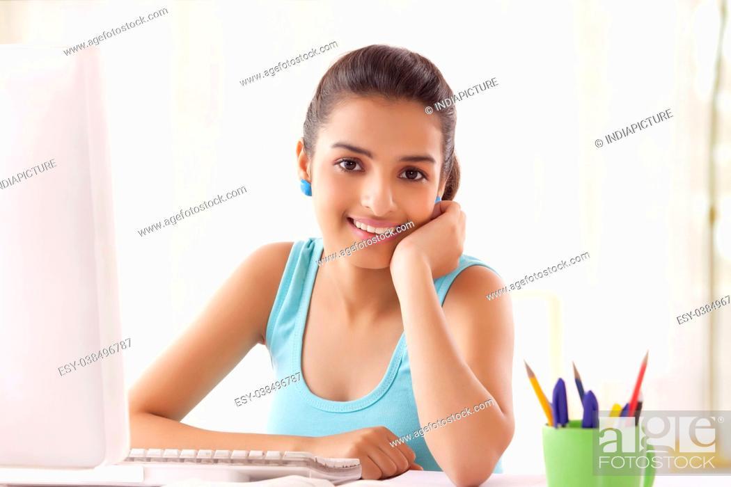 Stock Photo: Teenage Girls using computer at home.
