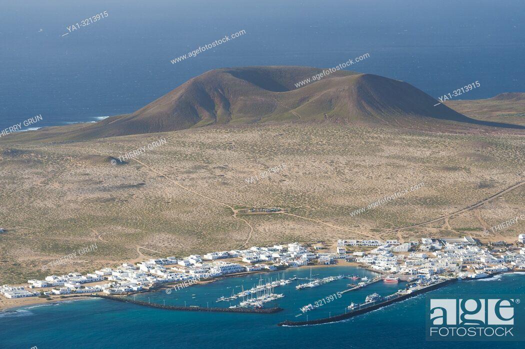 Stock Photo: Spain, Canary islands, Lanzarote, Graciosa island and Caleta del Sebo, viewed from Mirador del Rio.