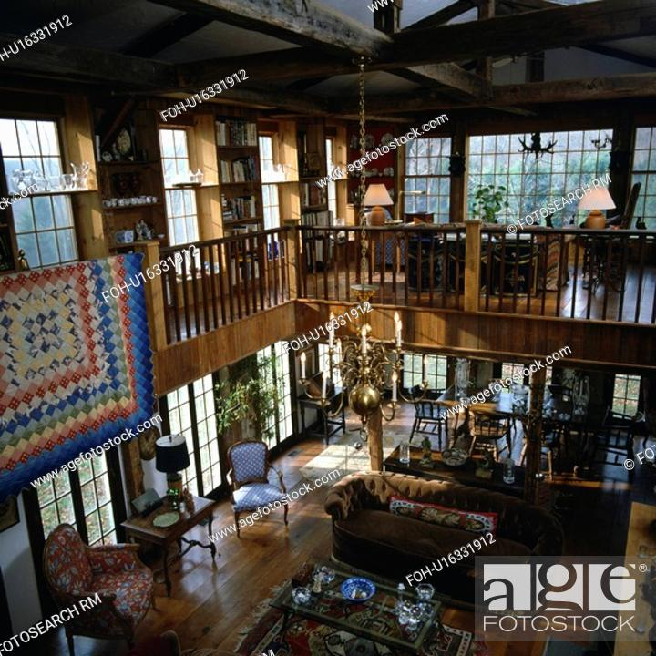 Aerial View Of Traditional Barn Conversion Living Room With Upper