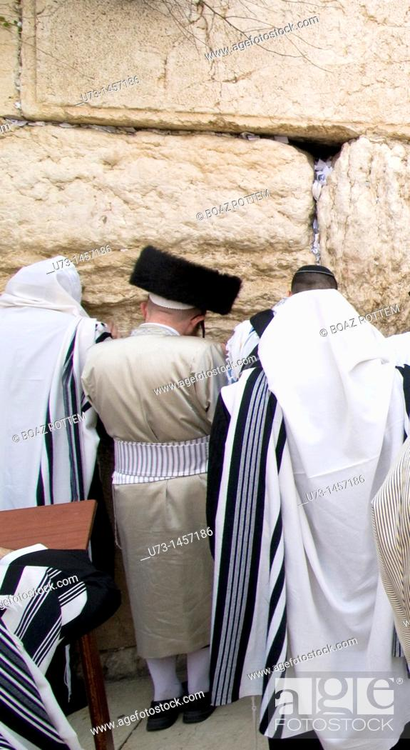 Stock Photo: Hasidic Orthodox Jews praying by the wailing wall in the old city of Jerusalem.