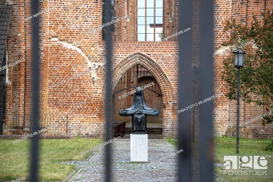 Stock Photo: 23 June 2021, Mecklenburg-Western Pomerania, Stralsund: Replica of a Pieta by Ernst Barlach in the Johanniskloster. Photo: Stephan Schulz/dpa-Zentralbild/ZB.