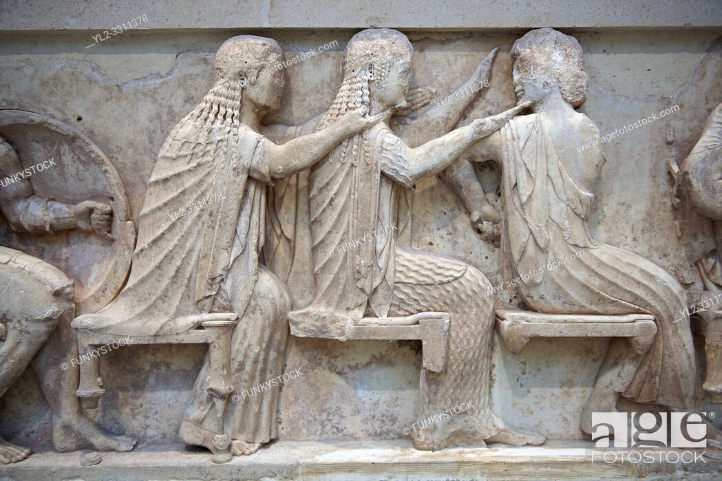 Stock Photo: Treasury of Siphnos East Frieze representing scenes from the Trojan War. 525 b. C. . From Left: Aris, Afrodite, Artemis. Delphi Archaeological Museum.