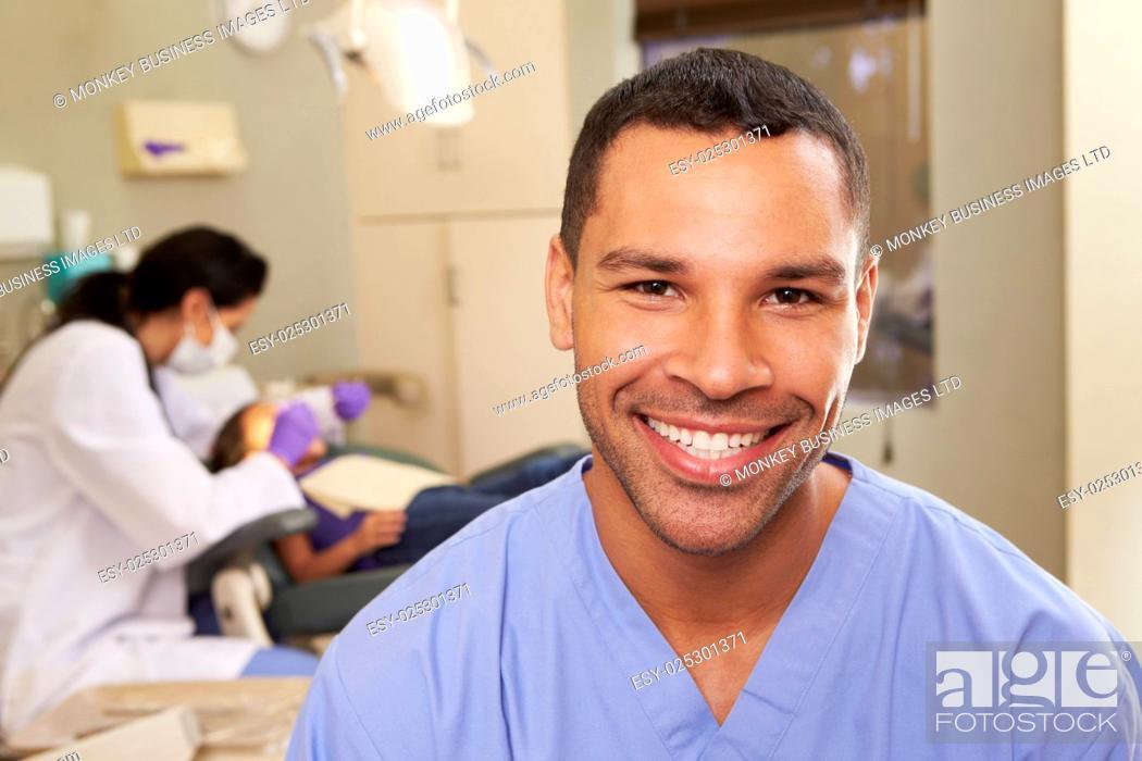 Stock Photo: Portrait Of Dental Nurse In Dentists Surgery.