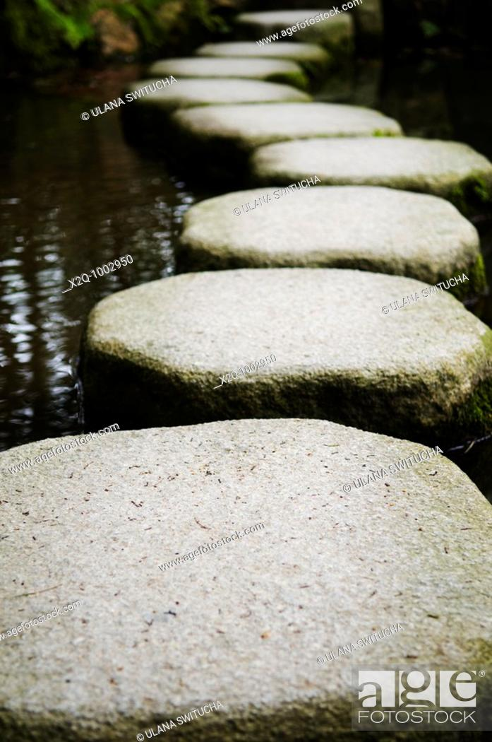 Stock Photo: Stepping stones over a pond in a zen garden in Kyoto Japan.
