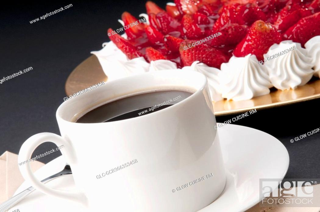 Stock Photo: Close-up of strawberry meringue with a cup of black coffee.