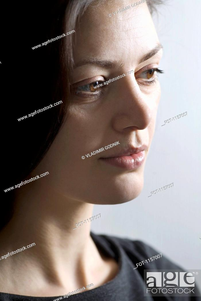Stock Photo: A woman looking away.