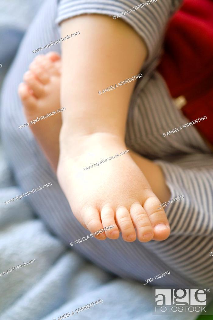 Stock Photo: Toddler baby feet.