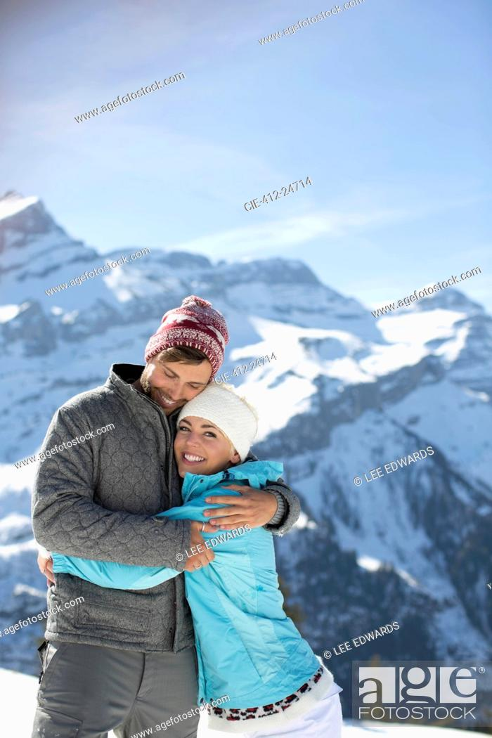 Stock Photo: Couple hugging at mountains.