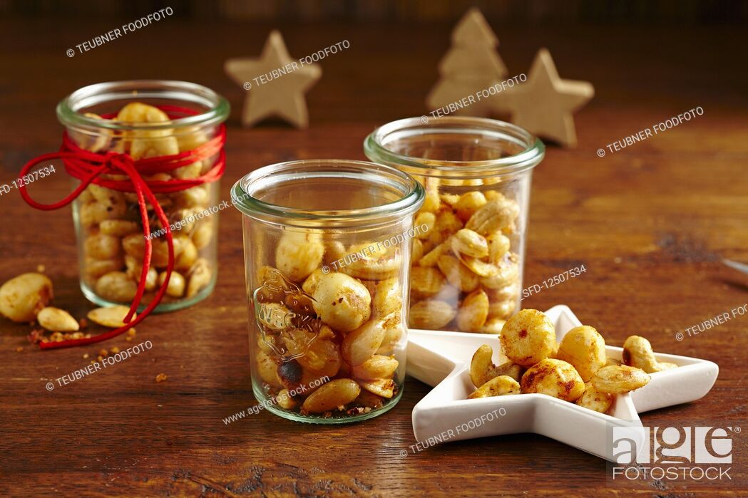 Stock Photo: Spicy nut mix in glass jars (Christmas gifting).