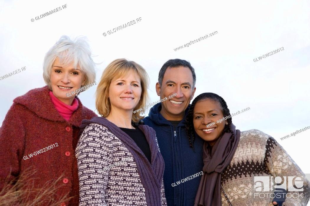 Stock Photo: Portrait of four friends smiling.