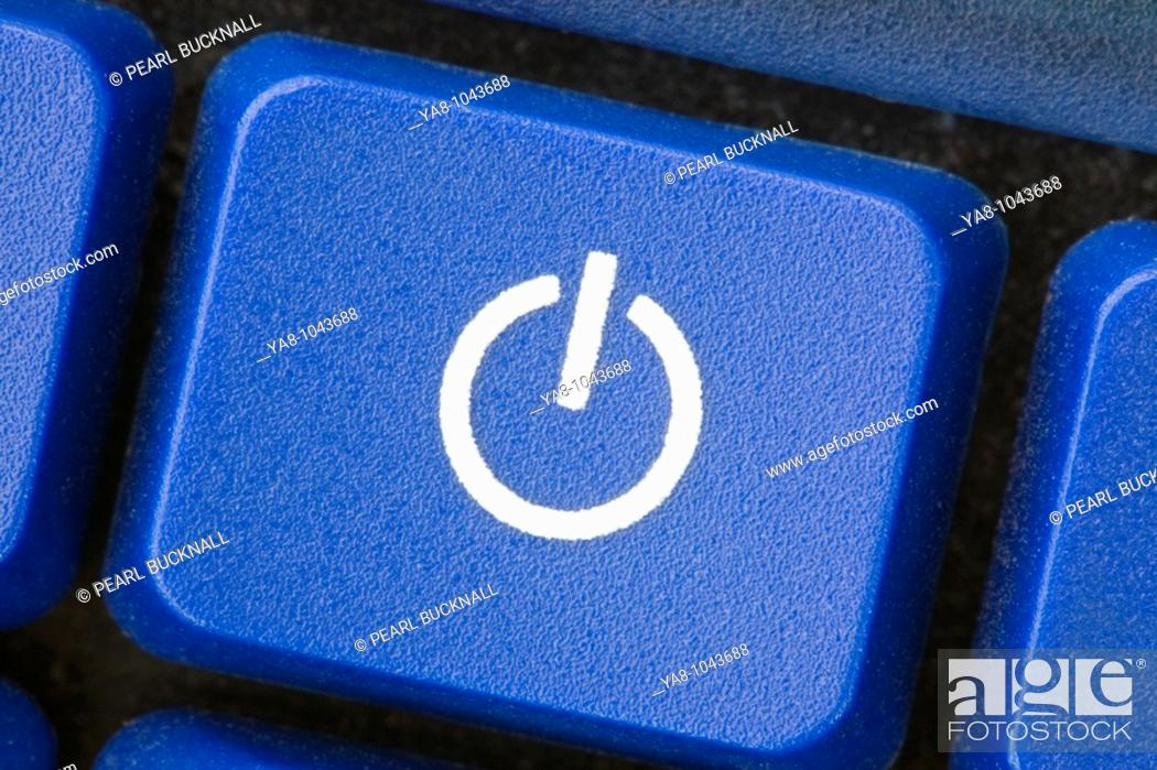 Stock Photo: Close-up of a white power switch symbol on blue key.