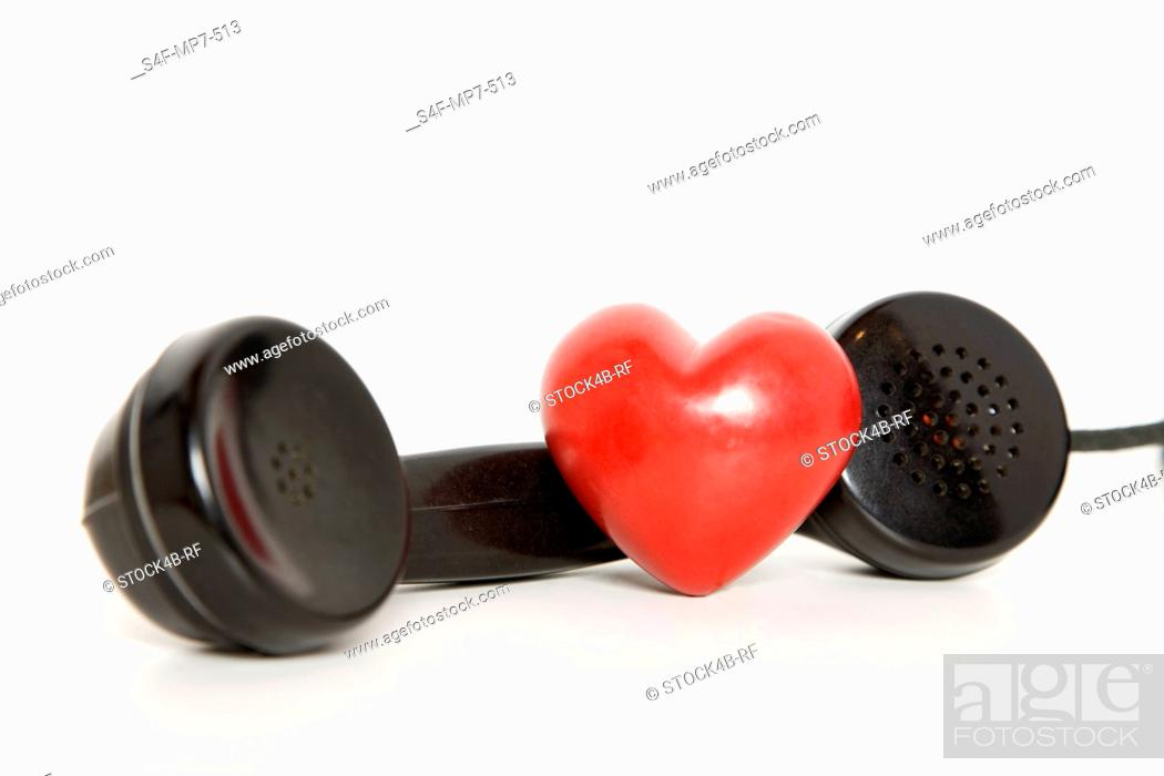 Stock Photo: Heart with old-fashioned telephone receiver.