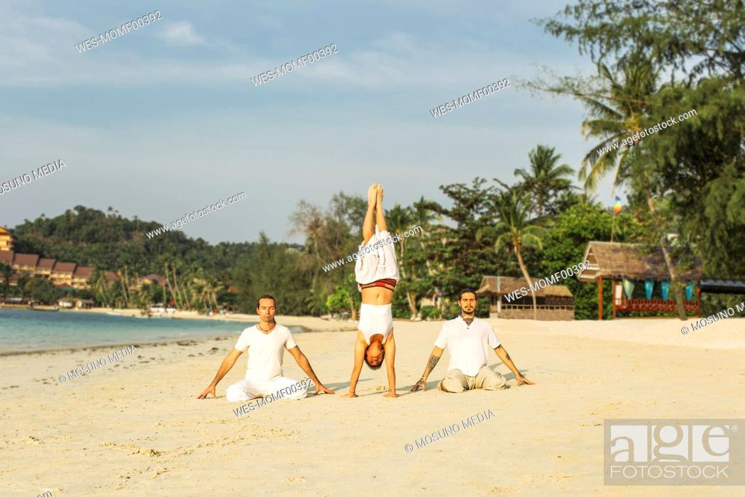 Thailand Koh Phangan Three People Doing Yoga On A Beach Stock Photo Picture And Royalty Free Image Pic Wes Momf00392 Agefotostock