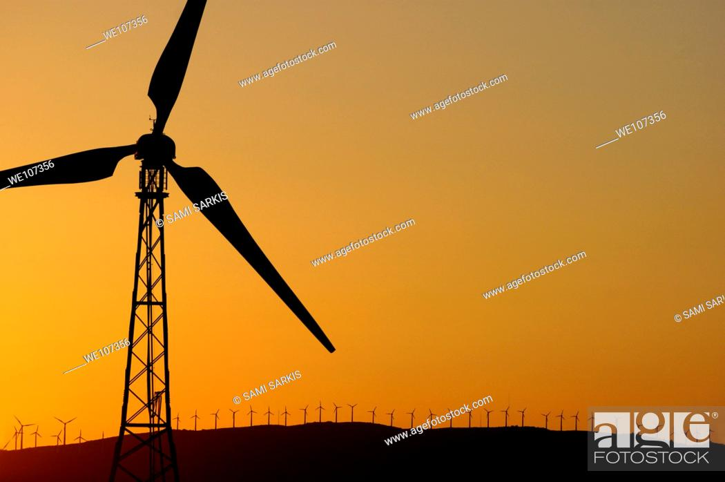 Stock Photo: Wind turbine on a ridge at sunset, Tarifa, Andalusia, Spain.
