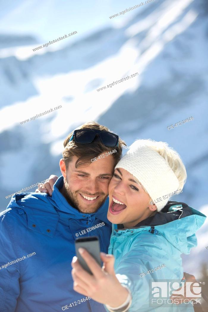 Photo de stock: Couple taking selfie in snow.