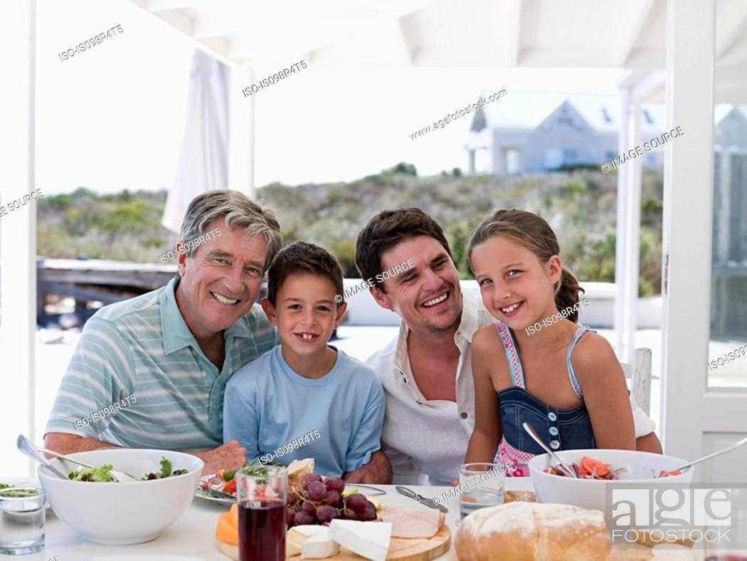 Stock Photo: Family meal outdoors.